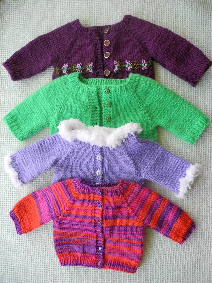 American Girl cardigan sweaters. All knit using Cindy Rice free pattern. 1. Plum with embroidery (first knitted). 2. Green, later added hat and scarf from other pattern sources. 3. Lavender with fake fur-look knitted borders. 4. And last, self stripping yarn. I just taught myself to knit!!