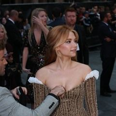 Haley Bennett has a wardrobe malfunction tended to at The Girl On The Train
