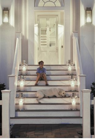 absolutely gorgeous / door steps !! lantern lighting + wood , brick & an all white home exterior. ( even the dog & child are perfectly beautiful ! ;)
