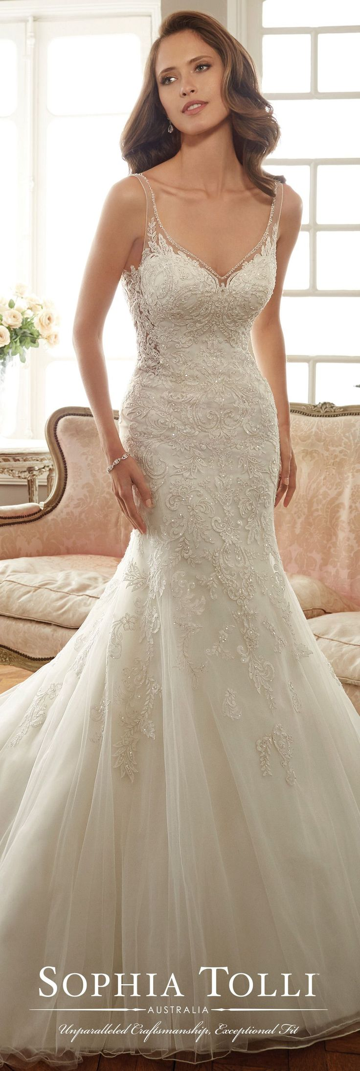 Look at this train! Sleeveless misty tulle fit and flare gown with slender illusion shoulder straps. Sophia Tolli - Y11707