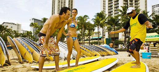 Take surfing lessons in Hawaii