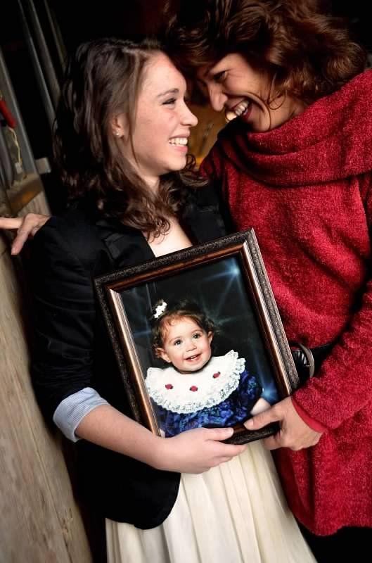 Senior Photo Shoot with a picture of herself as a baby and her mom...  Copyright Amber S. Wallace Photography
