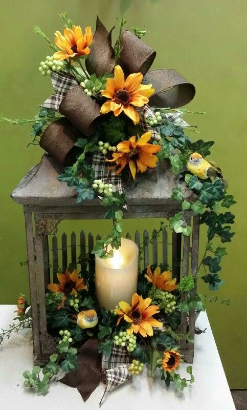 Spring time design accents this rustic lantern. Candle is Fireless all wax, runs on 2 d batteries, completely safe. Design by Twigs.