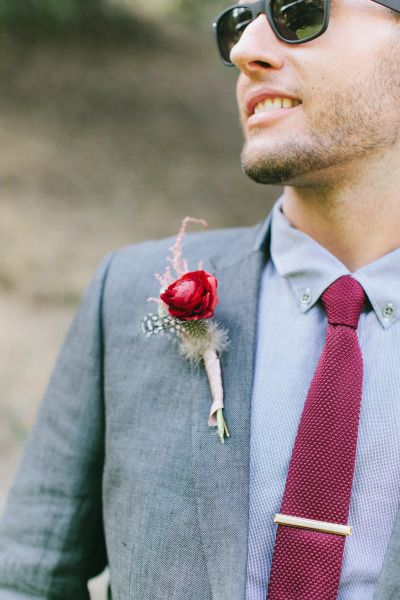 Feather detail on this boho boutonniere: http://www.stylemepretty.com/little-black-book-blog/2014/12/24/rustic-romantic-wrightwood-ranch-wedding/   Photography: Wai Reyes - http://waireyes.com/