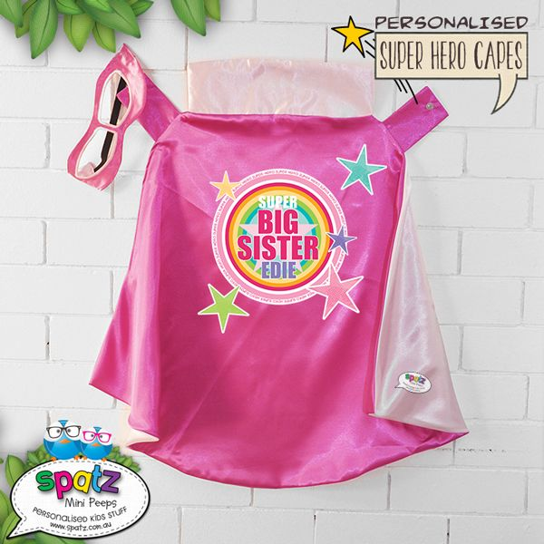 Big   Middle   Little Sister Super Hero Kids Cape – Pink / Light Pink  Is it a bird? Is it a plane? Nope, its way better than that. Its an awesome personalised SPATZ Mini Peeps® Personalised Kids Super Hero Cape! Complete and unique with a SUPER AWESOME design with your child's name placed on the back.