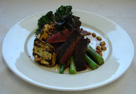 BBQ Kangaroo steak marinated and served with grilled seasonal vegetables, crispy sage leaves and a roasted pine nut beurre noisette