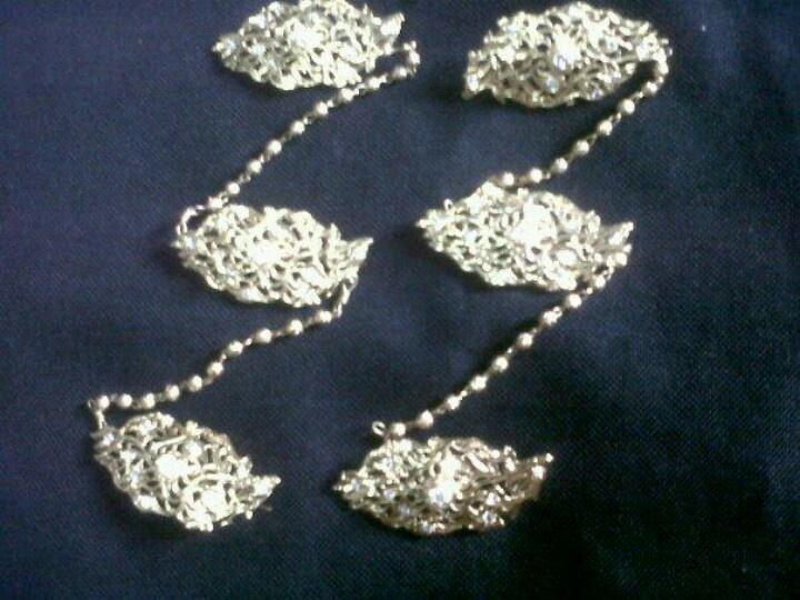 A set of Krosang brooches used to pin a Nonya's Kebaya blouse.