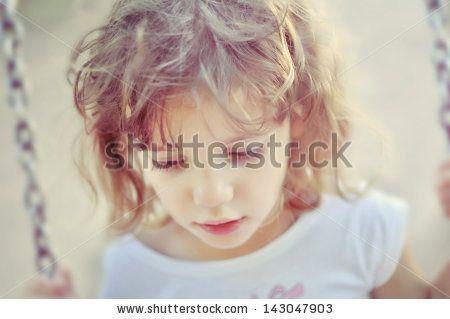 Little girl on swing with dreamy soft glow effect