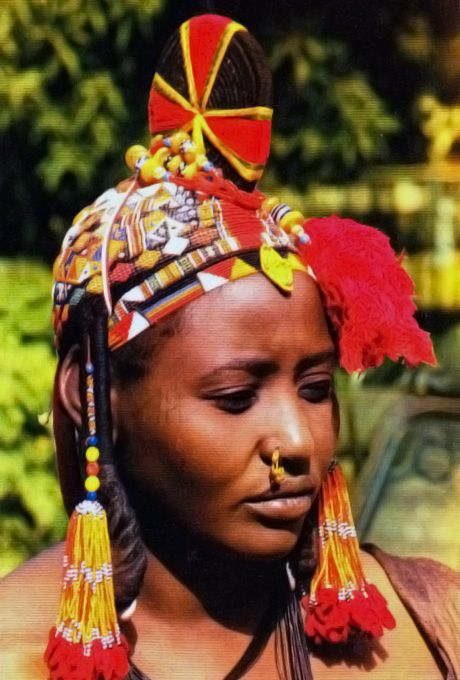 Africa | A Songhai (aka. Songhay, or Sonrai) woman, wearing a traditional headdress; worn by married women on special occasions. | Scanned postcard from Gao, Mali
