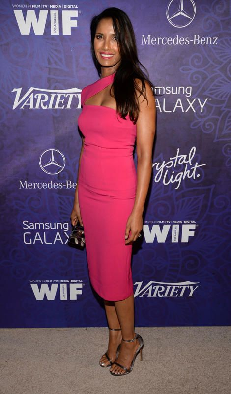 Padma Lakshmi A few days prior to the Emmys, Top Chef hostess with the mostest Padma Lakshmi attended a Variety-hosted fete in this yummy, watermelon-hued asymmetrical cocktail frock and strappy silver sandals. (8/23/14)