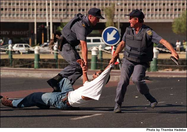 South African Police Service | south african police service officers pull away a protestor in cape ...