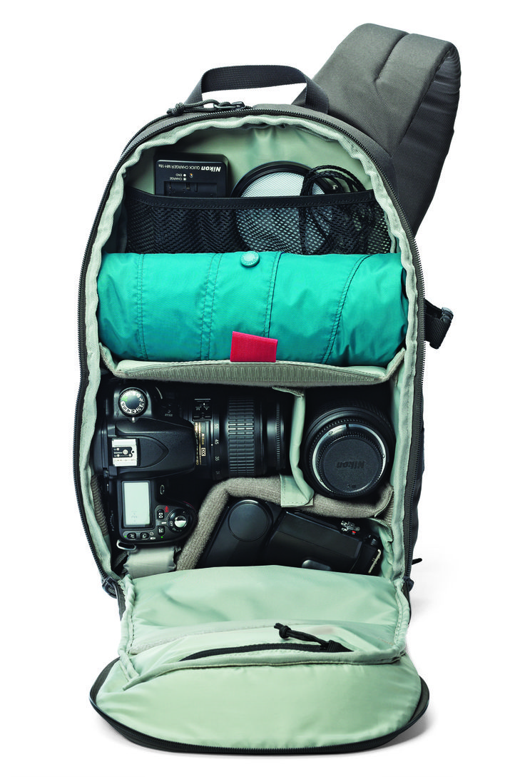 Built for speed is no idle claim with the @Lowepro Bags  Transit Sling 250 AW Camera Bag, a seriously feature packed, compact carryall that holds a DSLR, a whole lotta lens, tablet, mini-tripod and more, in an over-the-shoulder sling style that lets you swing the bag from back to front, without removing it, to reach a special quick-draw zippered side opening. Protection, ergonomics, flexible layout, a hideaway All Weather AW Cover that pops out to shroud the the bag against dust, rain and…