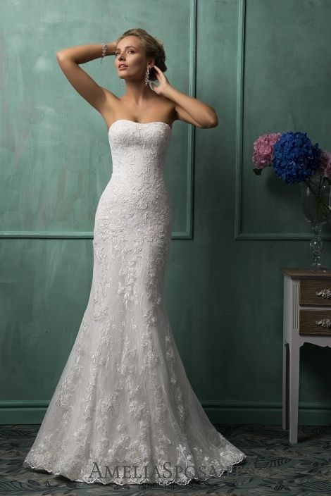 """Wedding dress Mirabella - AmeliaSposa.  Pure design and humbleness support the ultimate simplicity trend playing in frames of the rule """"the less – the better."""" A body-clinging silhouette lets demonstrate the true beauty of a lace and wonderful feminine lines – the primary adornment of any bride."""