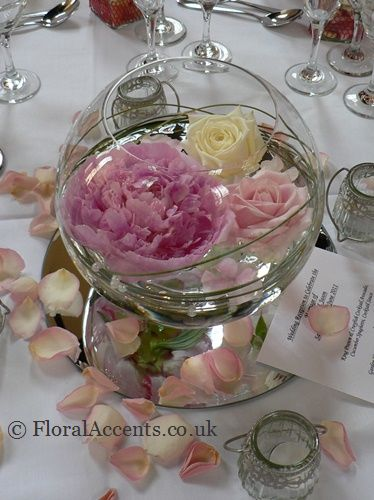 Elegant fishbowl design with floating flowers peonies