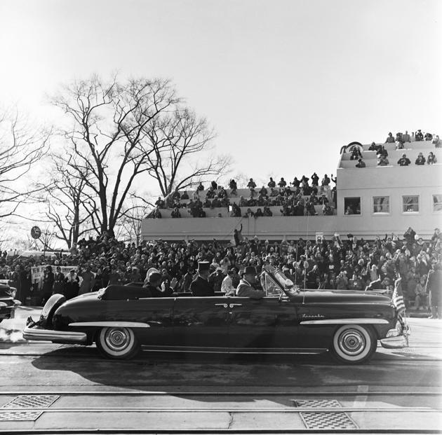 JFK and Jackie   Jan 20,  1961 - inaugural  parade.  Check out the car.
