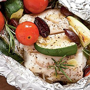 halibut with tomatoes, rosemary & zucchini in foil packets.