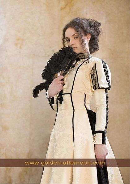 Reconstructed dress, circa 1889, made of adamascus, recalling the 19th-century interest in historical clothing.