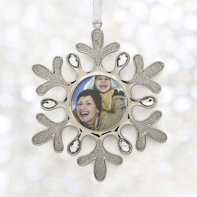Capture beautiful holiday memories and frame them in this adorable ornament to bring you joy for years to come!