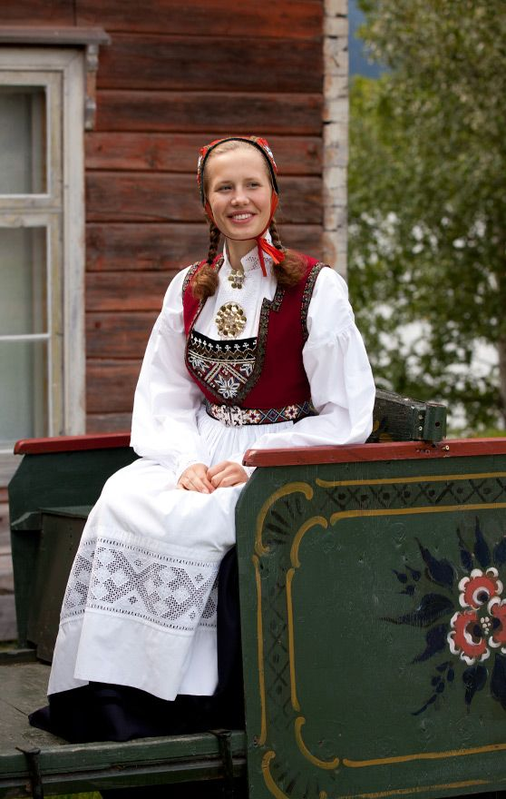 The National Bunad first introduced when Norway won independence from Sweden. Women from all over wear it and many Norwegian-Americans. Hardanger lace apron.