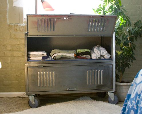 Designer Wes Bennett has an eye for upcycling. He built the 'Repurposed 36″ Rolling Vintage Storage' unit from a re-finished athletic locker. Bennett has created a bunch of furniture from reclaimed and salvaged lockers. Each hand-crafted piece is cleaned, stripped of old paint, and modified for its new purpose. In the case of the storage bureau pictured above, heavy duty casters and stylish hardware were added to the piece.