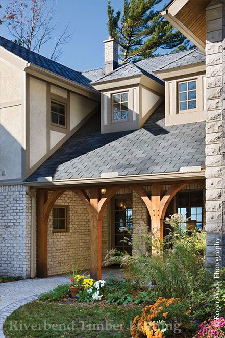 inviting entry ways are one architectural characteristic of a traditional timber frame home