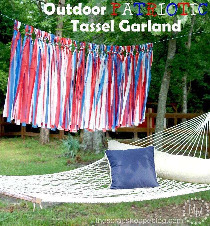 Outdoor Patriotic Tassel Garland. Turn dollar store tablecloths into a patriotic decoration for your next outdoor event!