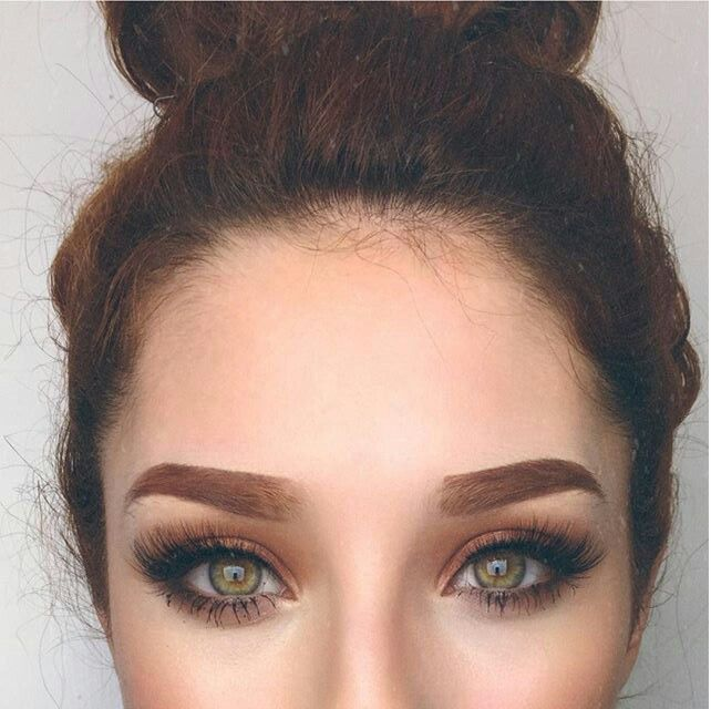 Makeup look to bring out green eyes.