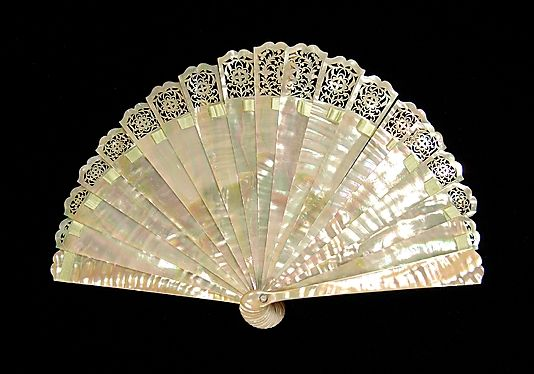 Brisé fan, mother of pearl and silk, French, fourth quarter 19th century, via the Met.