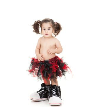 little girl wearing red and black tutu