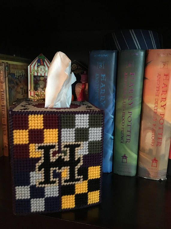 Custom designed, handcrafted Harry Potter tissue box cover. Each side depicts a different theme from the Wizarding World of Harry Potter. Harry Potters glasses and lightening bolt scar, Platform 9 and 3/4, Hogwarts, the Deathly Hallows, and the Mauraders Map are all displayed on this box. Perfect for any fan of the Wizarding World! Box cover measures 5 in x 5.5 in x 5 in and will fit any standard, cube-shaped tissue box. Made with sturdy plastic canvas and acrylic yarn, it will maintain ...