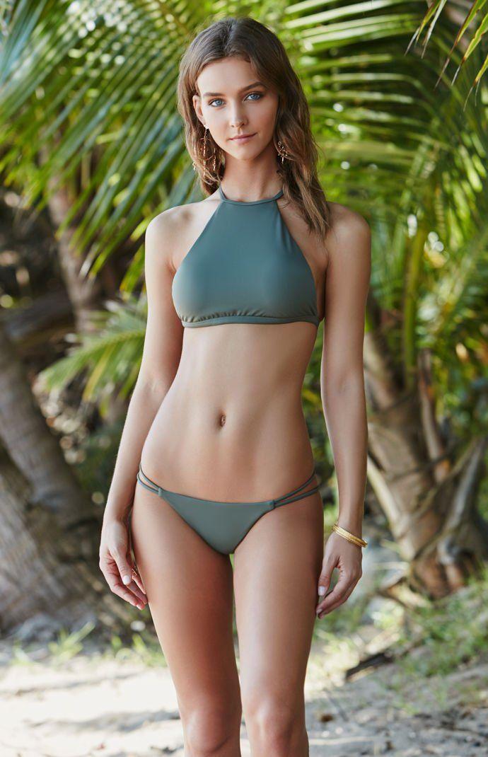 Sexy young female model girl in bikini washing motorcycle stock photo