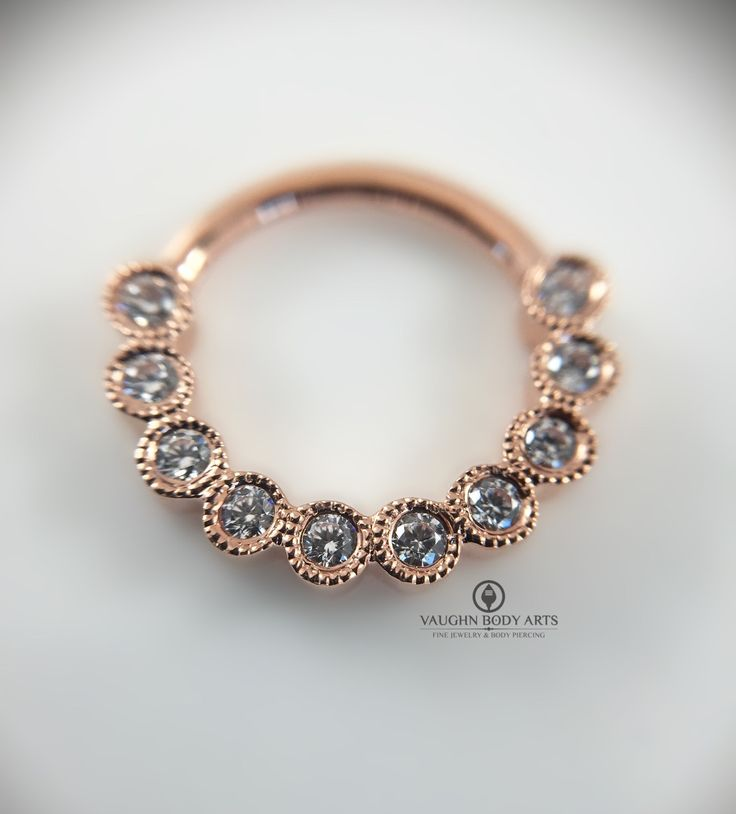 Look what just arrived today at the studio!   This 14k rose gold clicker is simply stunning. Bezel set 1.5mm CZ's with scalloped edges.   This piece would look amazing in your septum or daith, so come snag one before they're gone.   @vaughnbodyarts Monterey, CA