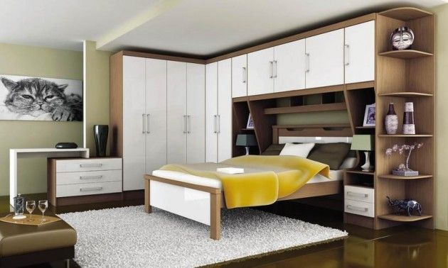 Quarto de casal planejado imagem de um quarto planejado de casal com móveis branco e bege