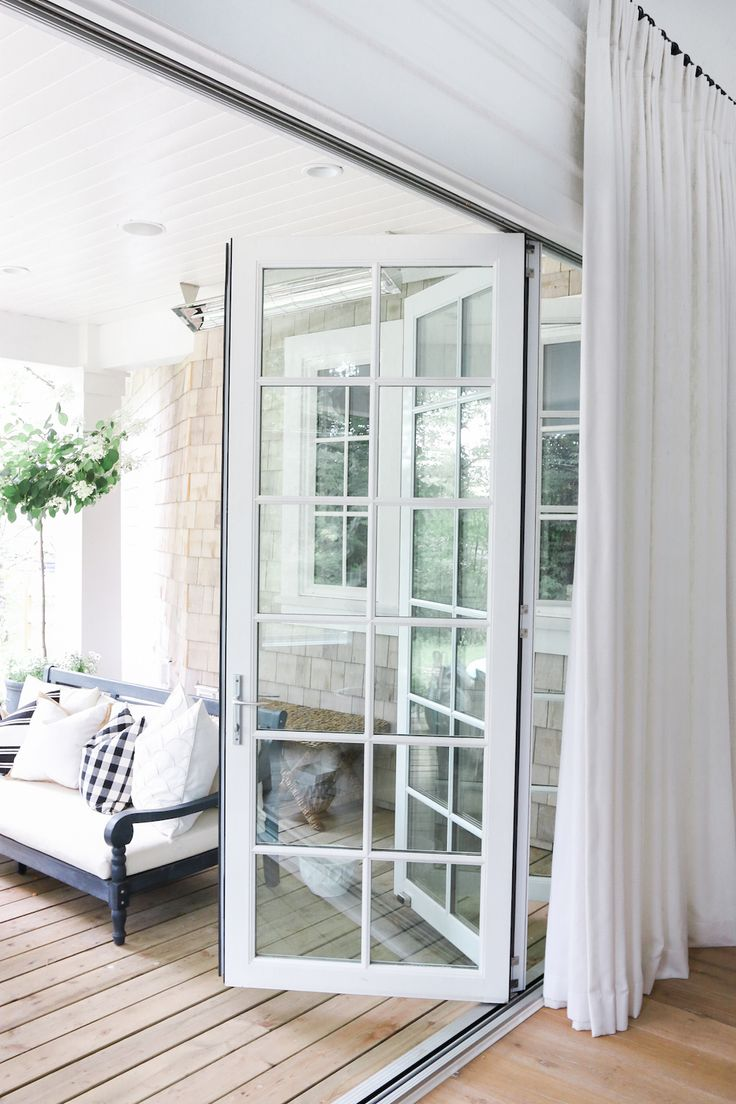 White folding doors | Outdoor Living | http://monikahibbs.com
