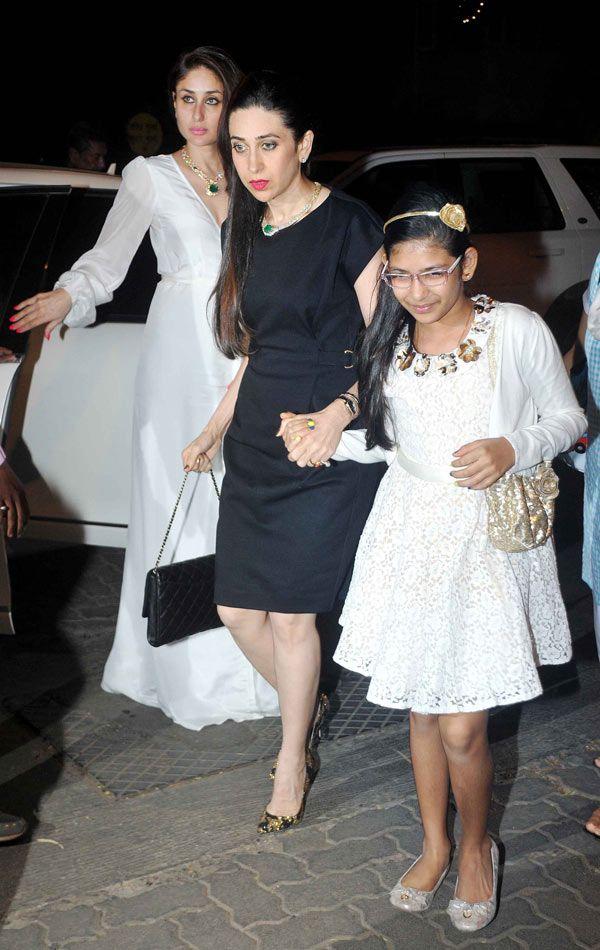 Kareena Kapoor Khan with sister Karisma Kapoor and niece Samaira at midnight mass at St. Andrew's Church, Bandra. #Bollywood #Fashion #Style #Beauty