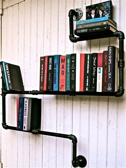Great use of raw building materials to create a functional awesome looking book shelf: industrial pipe bookshelf...I might install one of these in my bedroom