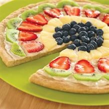 Easy Fruit Pizza   1 tube refrigerated Sugar Cookie Dough    8 ounces Cream Cheese, softened  1/4 cup powdered sugar  1 teaspoon vanilla    Enough bright, colorful fruit to cover your pizza.