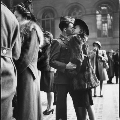 Alfred Eisenstaedt - couple in Penn Station sharing farewell kiss before he ships off to war during WW2