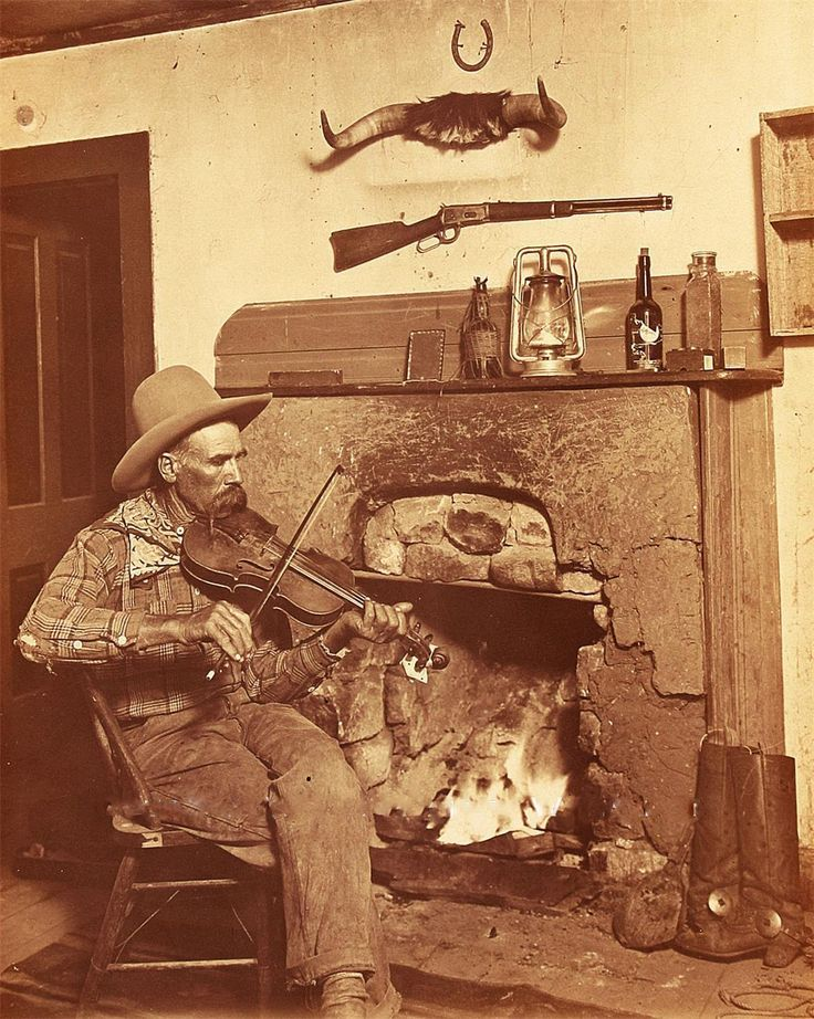 OLD WEST COWBOY PLAYING FIDDLE BY FIRE 1898