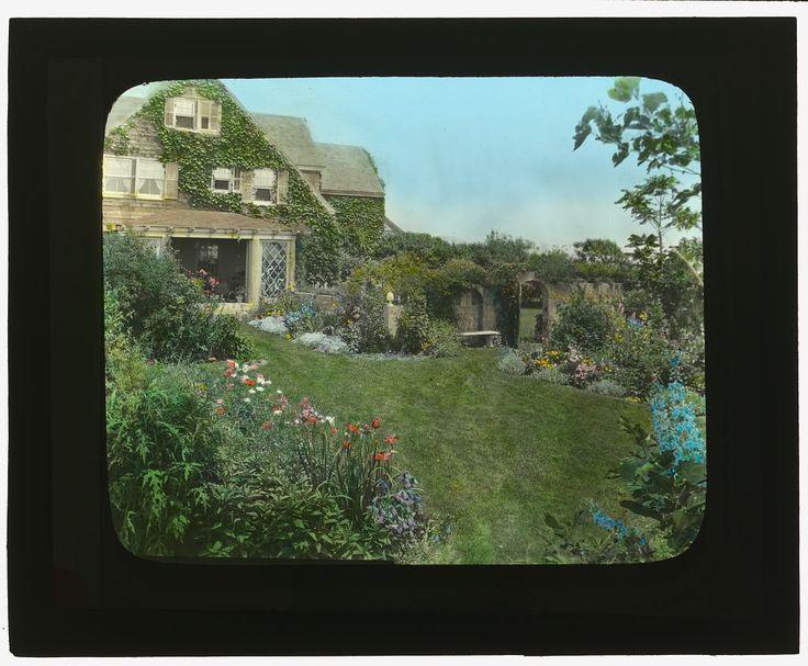"https://flic.kr/p/c18oNU | [""Gray Gardens,"" Robert Carmer Hill house, Lily Pond Lane, East Hampton, New York. (LOC) | Johnston, Frances Benjamin,, 1864-1952,, photographer.  [""Gray Gardens,"" Robert Carmer Hill house, Lily Pond Lane, East Hampton, New York. Pathway to sun room]  [ca. 1916]  1 photograph : glass lantern slide, hand-colored ; 3.25 x 4 in.  Notes:  Site History. House Architecture: Joseph Greenleaf Thorp, 1897. Landscape Associated Name: Anna Gilman (Mrs. Robert C.) Hi..."