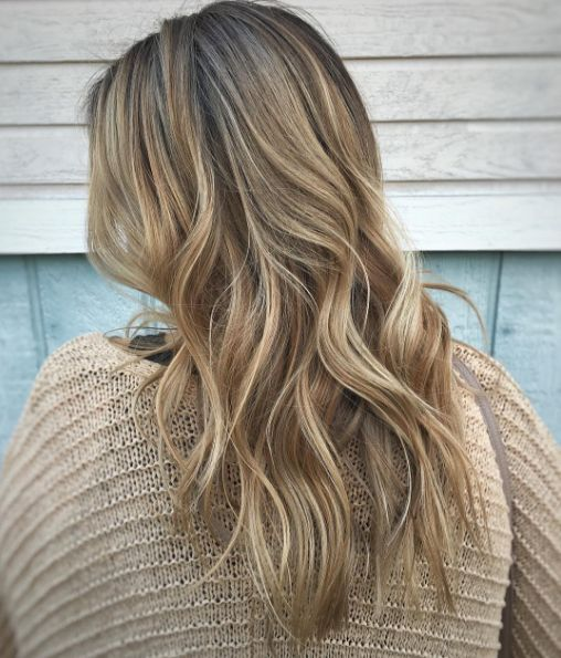 Lived-in rooty dark blonde balayage is an easy transition from winter to spring, or summer to fall. Work by Aveda stylist @ShearAddiction. Formula in comments.