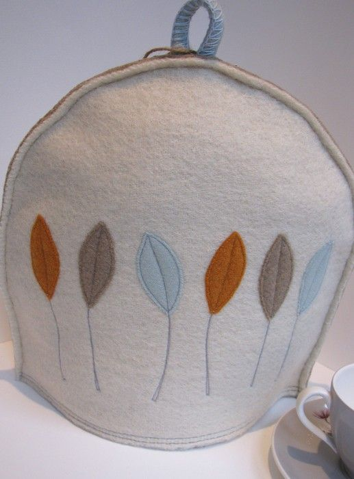 tea-cosy in fall design by Elizabeth Cook - really like it       appliqued & machine-stitched, made from reclaimed wool fabrics. each cosy is individually made by elizabeth & will vary slightly. all cosies are double lined for extra insulation              by elizabeth cook