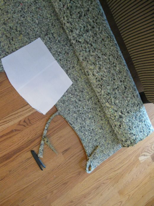 Usually, you use foam and batting from a craft store, but that stuff is expensive and I didn't want to invest more than what I even paid for the chairs.  Luckily the idea lightbulb came on when, after watching a DIY network show where they used carpet padding to upholster, I saw a giant roll of carpet padding at a thrift store for $4.  And again we're in business!