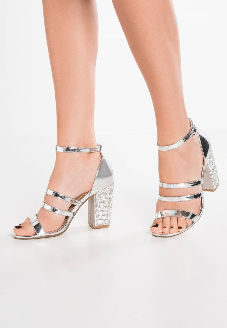 "Dorothy Perkins. SHADOW - Sandals - silver. Pattern:plain. Sole:synthetics. heel height:3.5 "" (Size 4). Padding type:Cold padding. Shoe tip:open. Heel type:block heel. Lining:imitation leather/ textile. detail:rhinestones,elasticated. shoe f..."