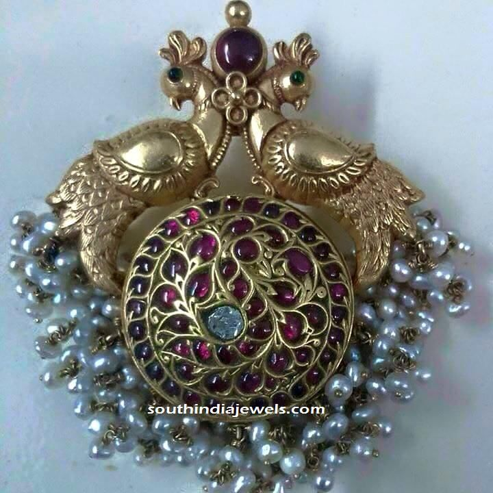 22k gold antique peacock pendant studded with kemp rubies, emeralds and pearl clusters. For inquiries please contact 086067 74555.
