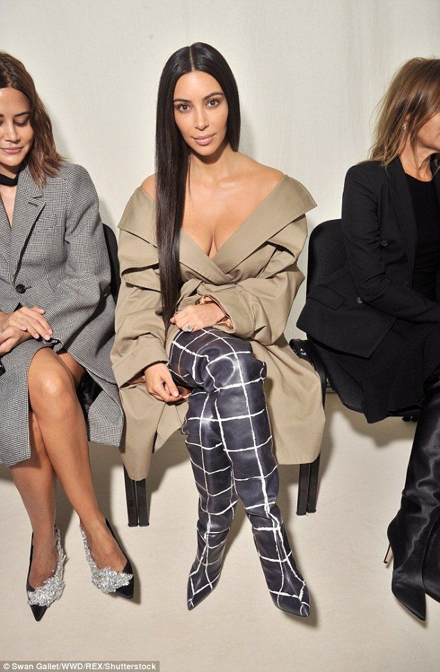 Stunner: She teamed the number with a pair of thigh-high leather boots which had white squares emblazoned throughout and looked like trousers at first glance