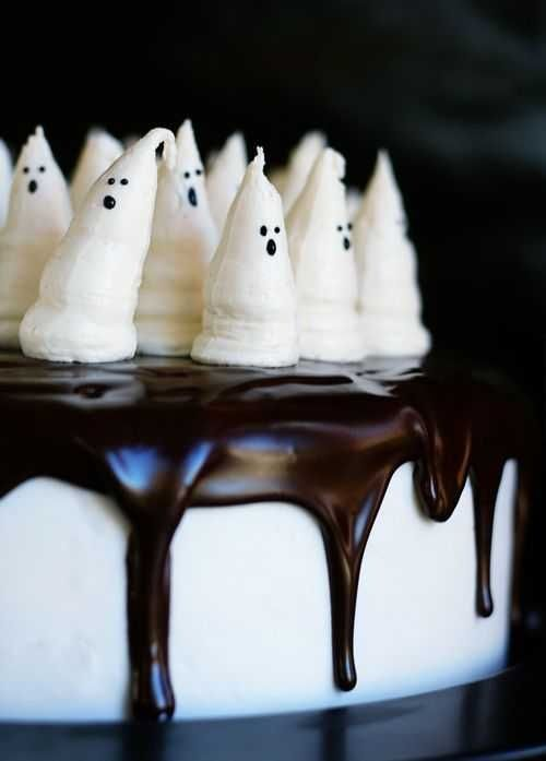 "Halloween Ghost Cake. Here we have a very good recipe from ""i am baker"" for Marshallow Buttercream Frosting thats fluffy and stands up nicely in peaks. To go along with this frosting is a tasty Red Velvet Cake recipe you need to try, its ever so yum! SE"