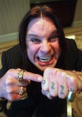 """Ozzy Osbourne """"Ozzy"""" knuckle tattoo."""
