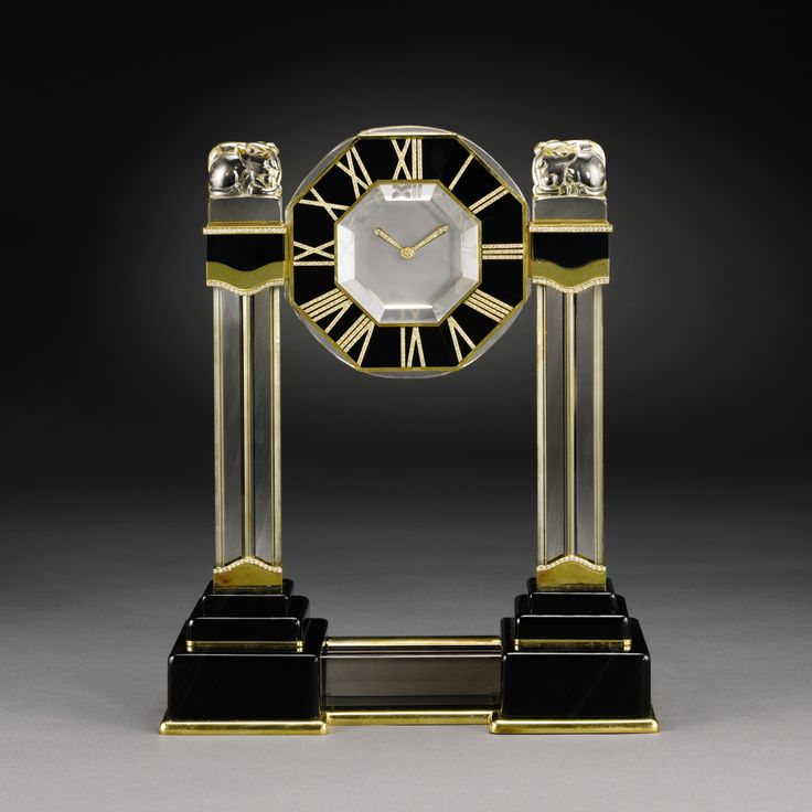 CARTIER CHINESE MYTHICAL CREATURE MYSTERY CLOCK A LARGE, VERY RARE AND IMPORTANT YELLOW GOLD, DIAMOND, ROCK CRYSTAL, SMOKEY QUARTZ, ONYX AND BLACK AGATE MYSTERY CLOCK CIRCA 1995 CASE NO 220932 HPSR 0289