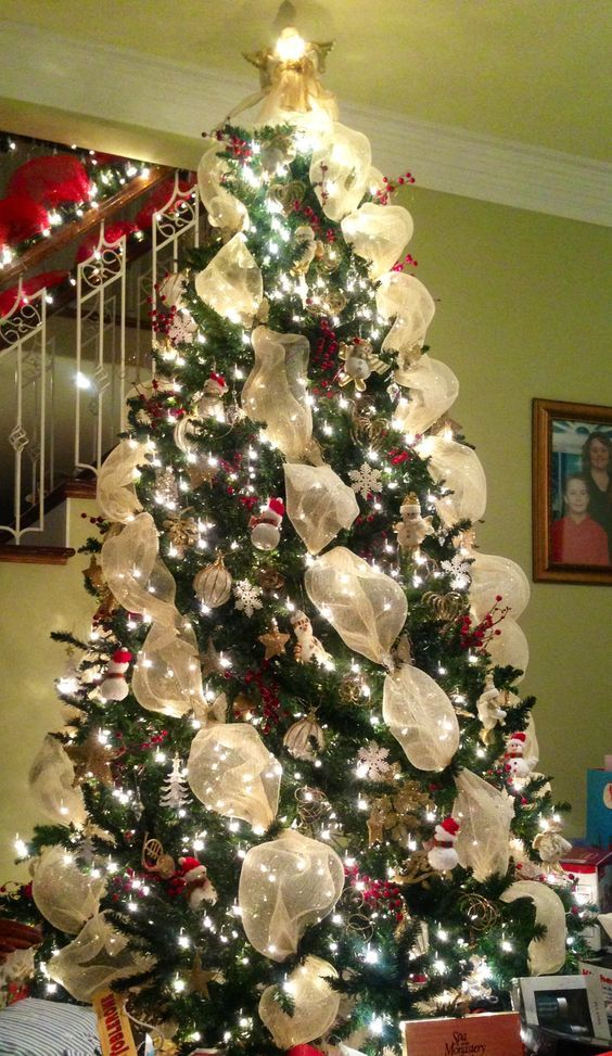 Angled Gold Mesh Decorated Christmas Tree.